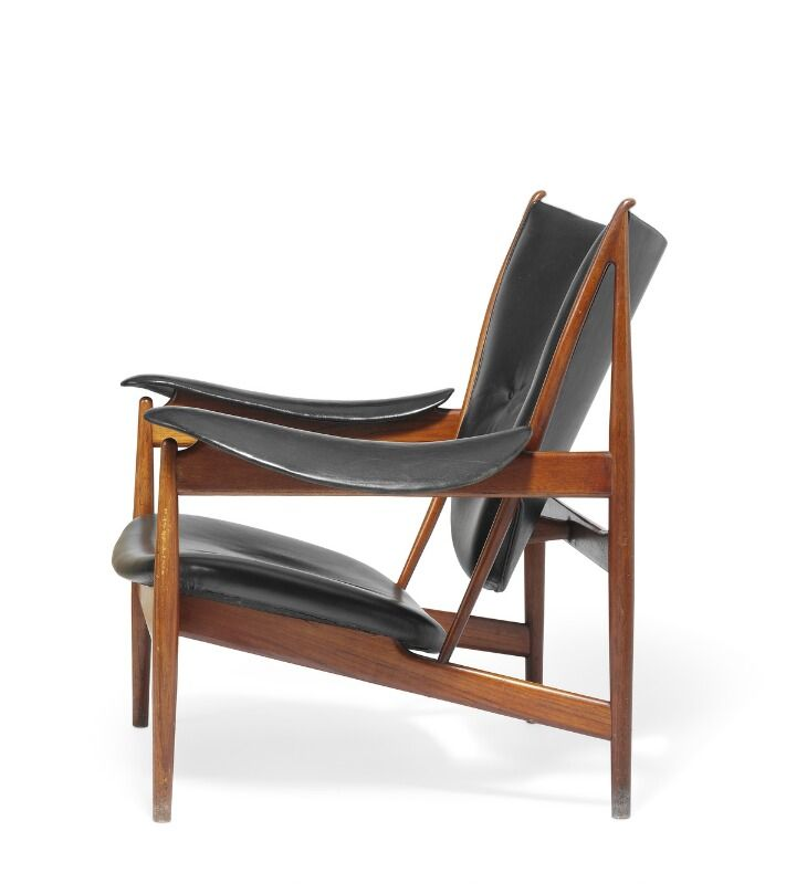 A teak easy chair Seat armrests and