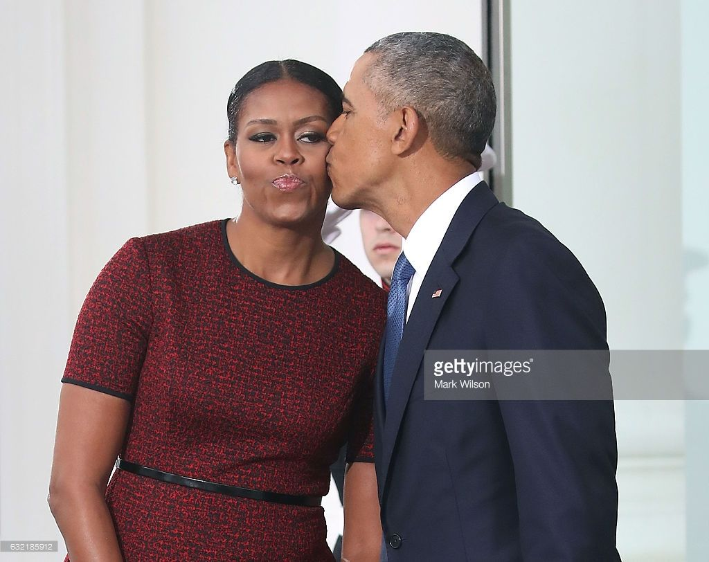 President Barack Obama gives a kiss to his wife first lady Michelle Obama before the arrival of President-elect Donald Trump and his wife Melania Trump, at the White House on January 20, 2017 in Washington, DC. Later in the morning President-elect Trump will be sworn in as the nation's 45th president during an inaugural ceremony at the U.S. Capitol.
