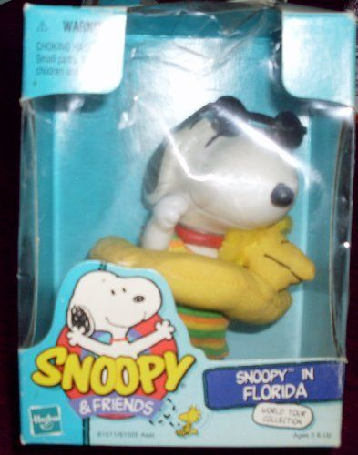 """Peanuts Snoopy & Friends Jointed Doll 1999 - Snoopy in Florida - Swimsuit & Woodstock Swim Ring by Hasbro. $26.99. His deluxe clothing is removable. Hasbro SNOOPY & FRIENDS Collectible Series 1999. Includes a rainbow swimsuit, sunglasses, and WOODSTOCK yellow floatie ring. SNOOPY in FLORIDA Doll is approx. 5"""" tall, jointed & composed of rubber. NEW - MINT DOLL - Never removed from box.  Box has received slight damage, but Snoopy is perfect!  From the Hasbro SNOOPY & FRIENDS Co..."""