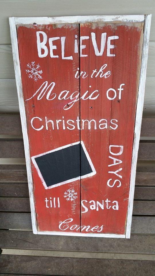 Christmas blackboard to mark the days before Christmas.  Old wood fence