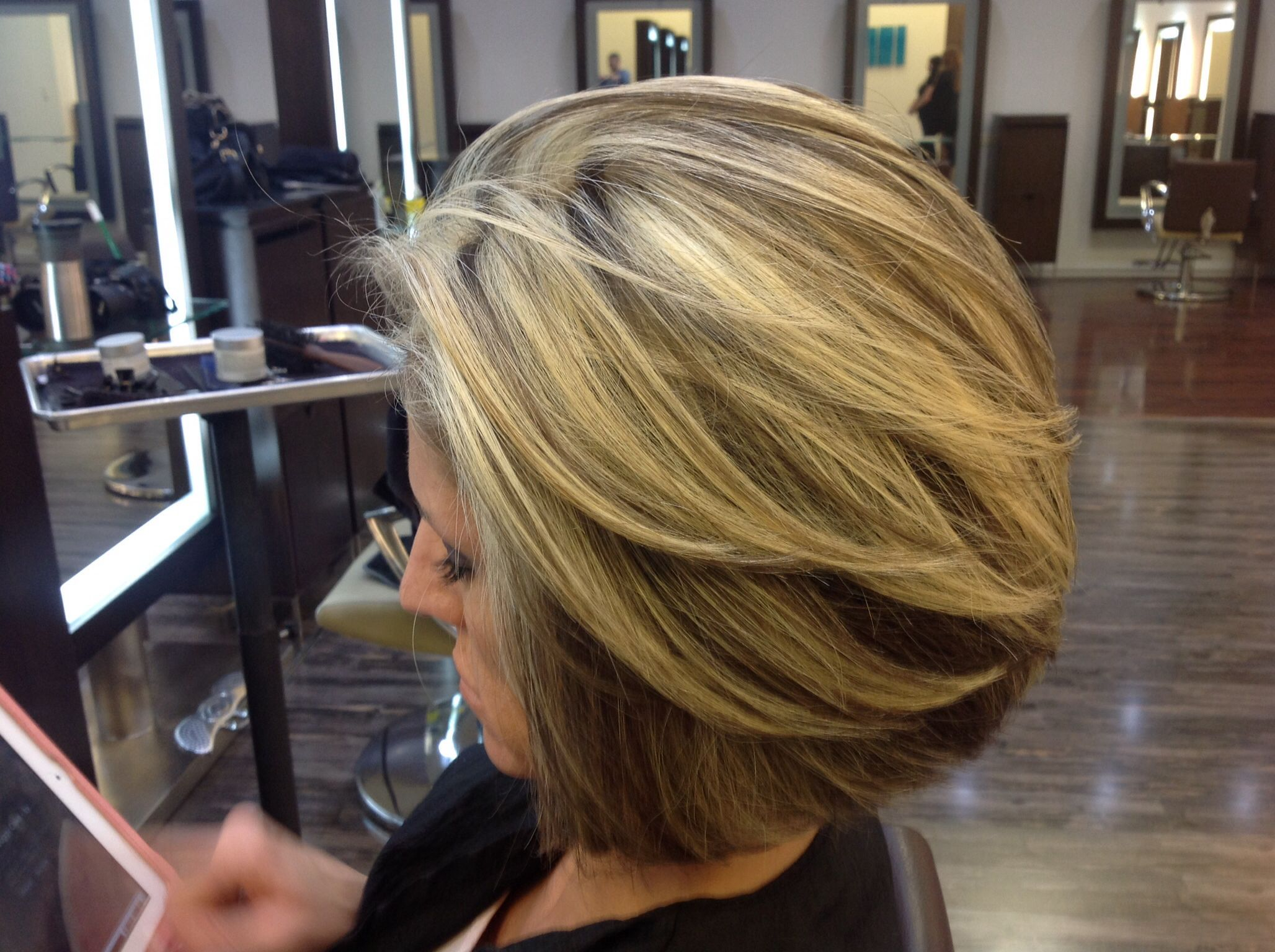 Layered bob with pattern matching blonde highlights by Andre Aronica