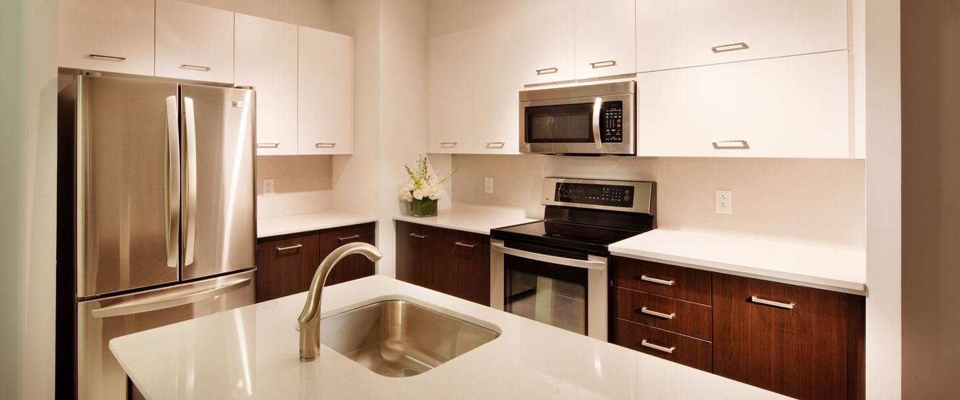 White 42 Upper Kitchen Cabinets And Espresso Finished Lower Cabinets Eco By Cosentino Polar Cap Upper Kitchen Cabinets Kitchen Inspirations Kitchen Cabinets