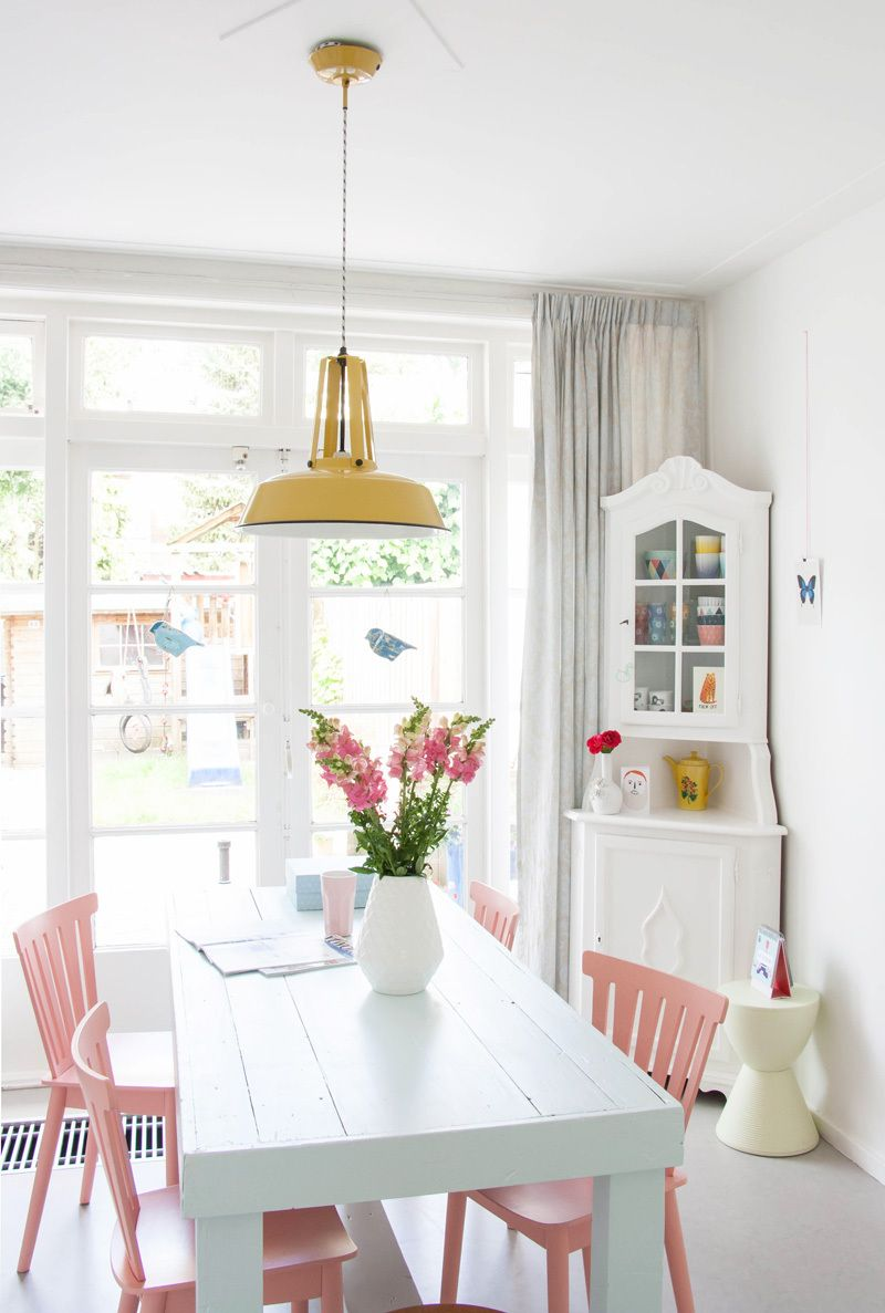 Bright white with neon pops, amazing dining area // Homes with Heart by @avenuelifestyle for @decor8