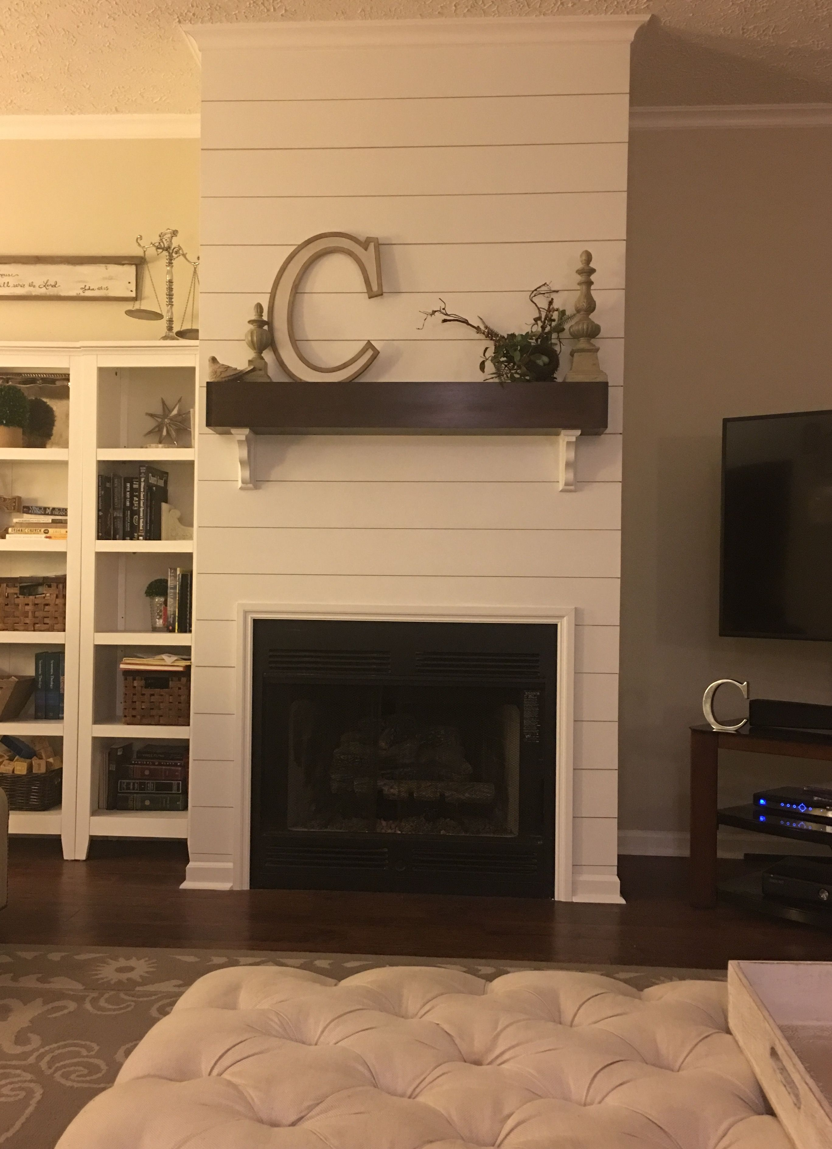 DIY Shiplap fireplace wall and floating wooden mantle