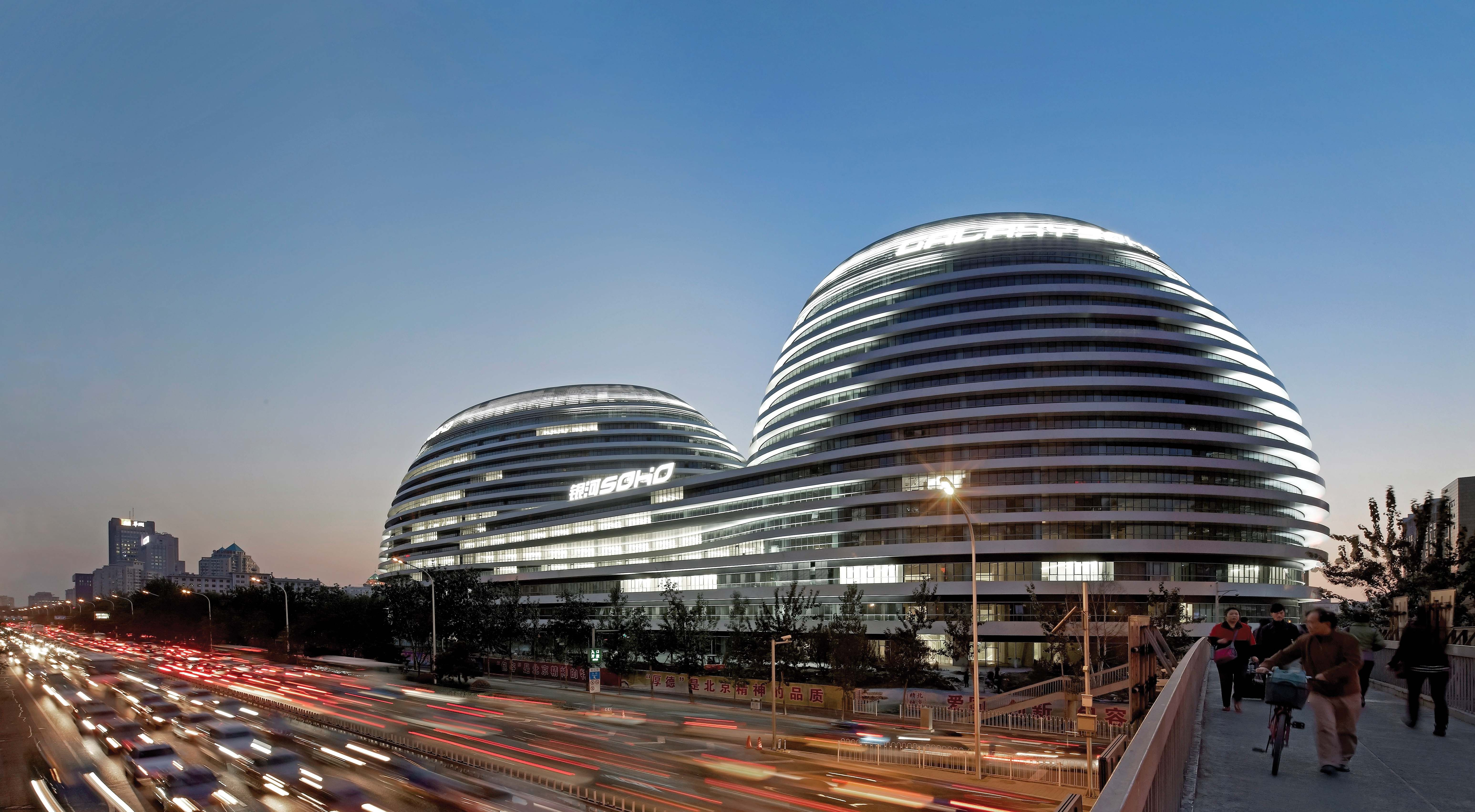 Designed by Zaha Hadid Architects, the Galaxy SOHO project in Beijing for SOHO China is a 330,000m2 office, retail and entertainment complex that will become an integral part of the living city. Its architecture is a composition of four continuous, flowing volumes that are set apart, fused or linked by stretched bridges. Photo: Hufton + Crow.
