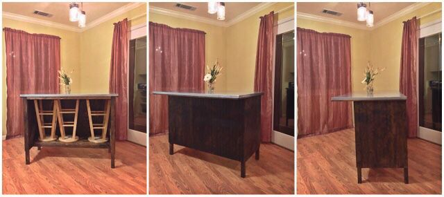 DIY kitchen island with a hide away cubby for storing stools.