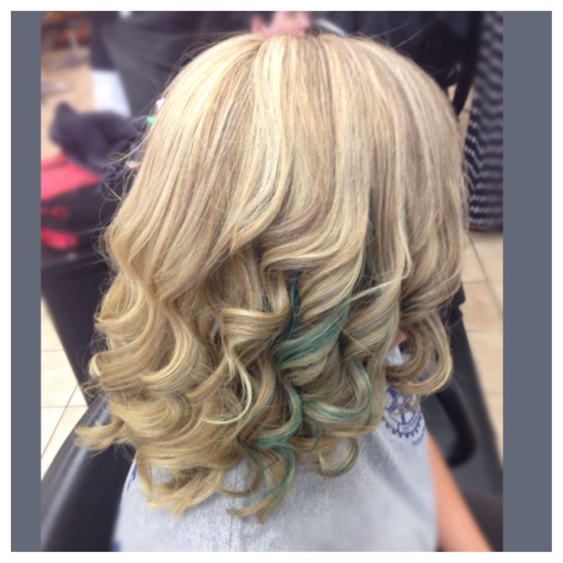 heavy foil fine lowlights on blonde hair with a teal panel for