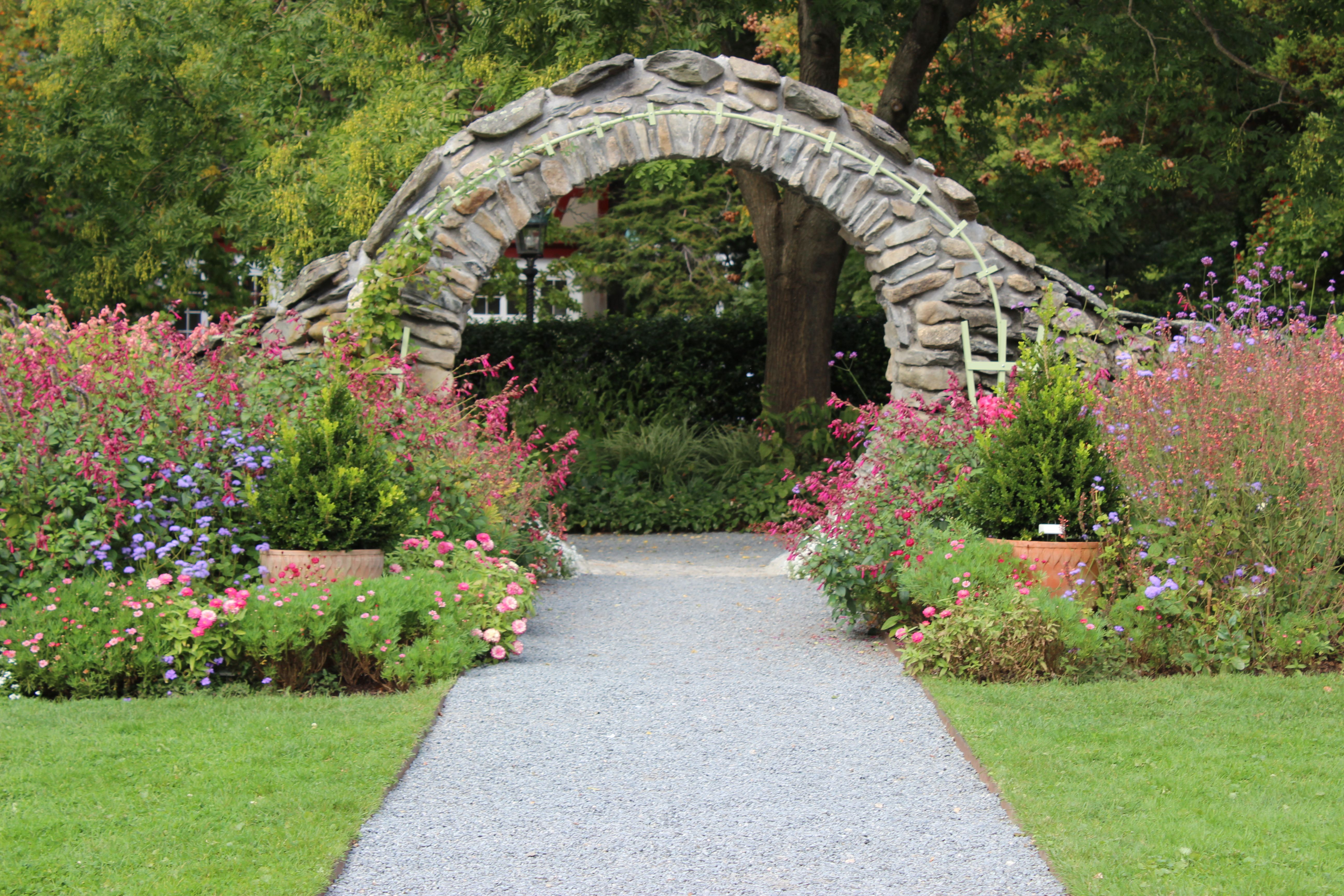 This Moon Gate At Blithewold Features Perennial Beds On Each Side