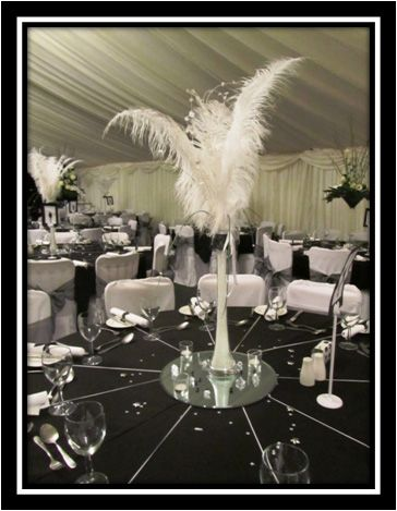 Dramatic ostrich feather centrepieces for a black and for Black table centrepieces
