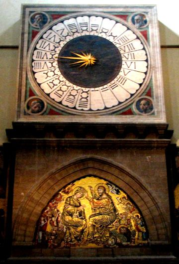 Clock in Basilica di Santa Maria del Fiore (Florence Cathedral) Designed by Paolo Uccello in 1443.  Clock still works.  Florence, ITALY