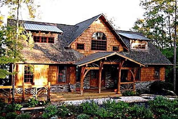 camp stone is a timber frame house plan design built with true timbers its craftsman
