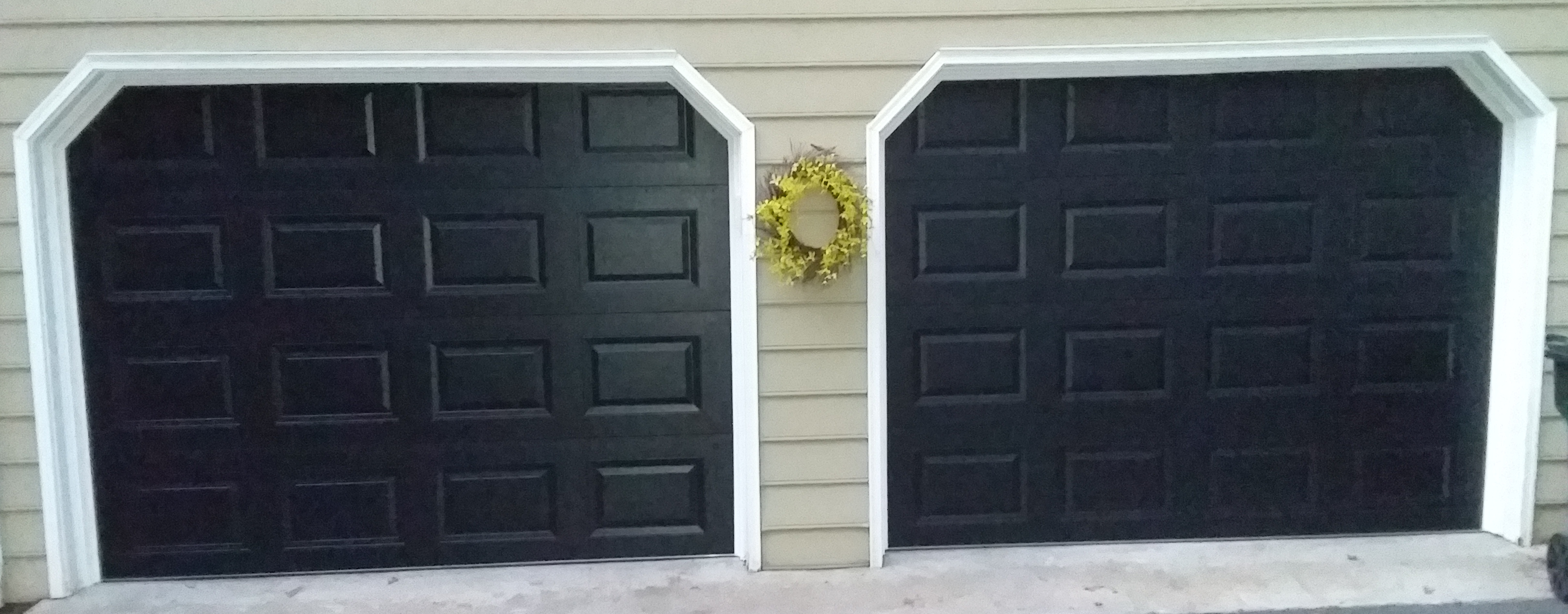 Two 9x7 Model 2216 Black Raised Short Panel Double Steel Garage Doors Installed By The Richmond Store Team Garage Doors Double Garage Door Door Installation