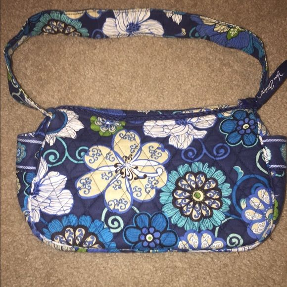 Vera Bradley purse Vera Bradley purse it is used. There is a spot on the inside but nothing major on the outside I can post more pictures if needed Vera Bradley Bags Mini Bags