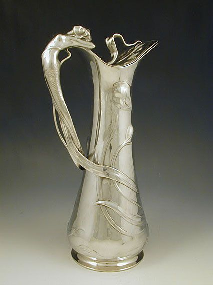 Polished pewter flagon with a handle in the form of a figural art nouveau mermaid. Country of Manufacture Germany. Date c.1906
