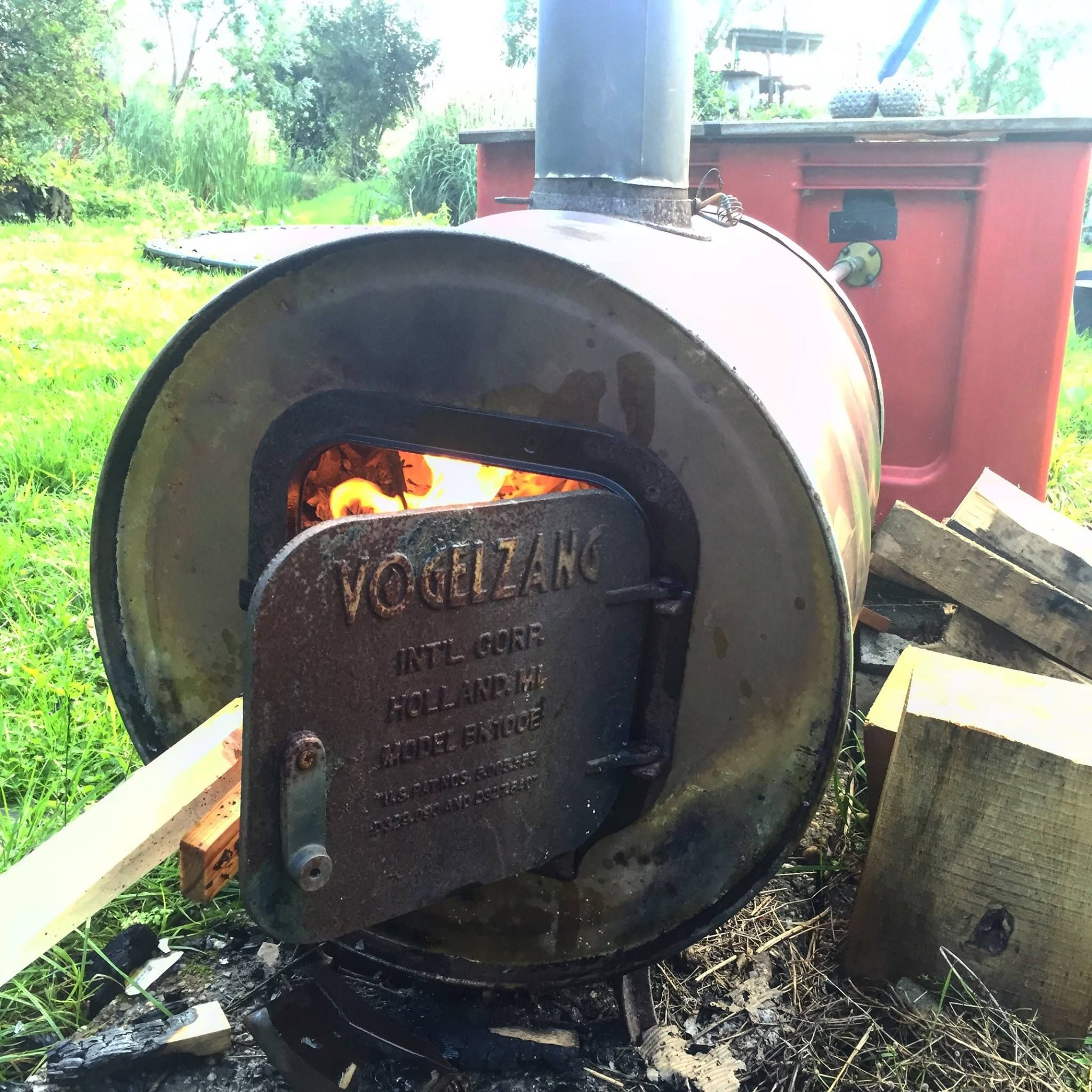 an old oil barrel , the best is a stainless one. and a Vogelzang stove kit.http://www.amazon.com/Vogelzang-Barrel-Stove-Model-BK100E/dp/B0018JBFS8