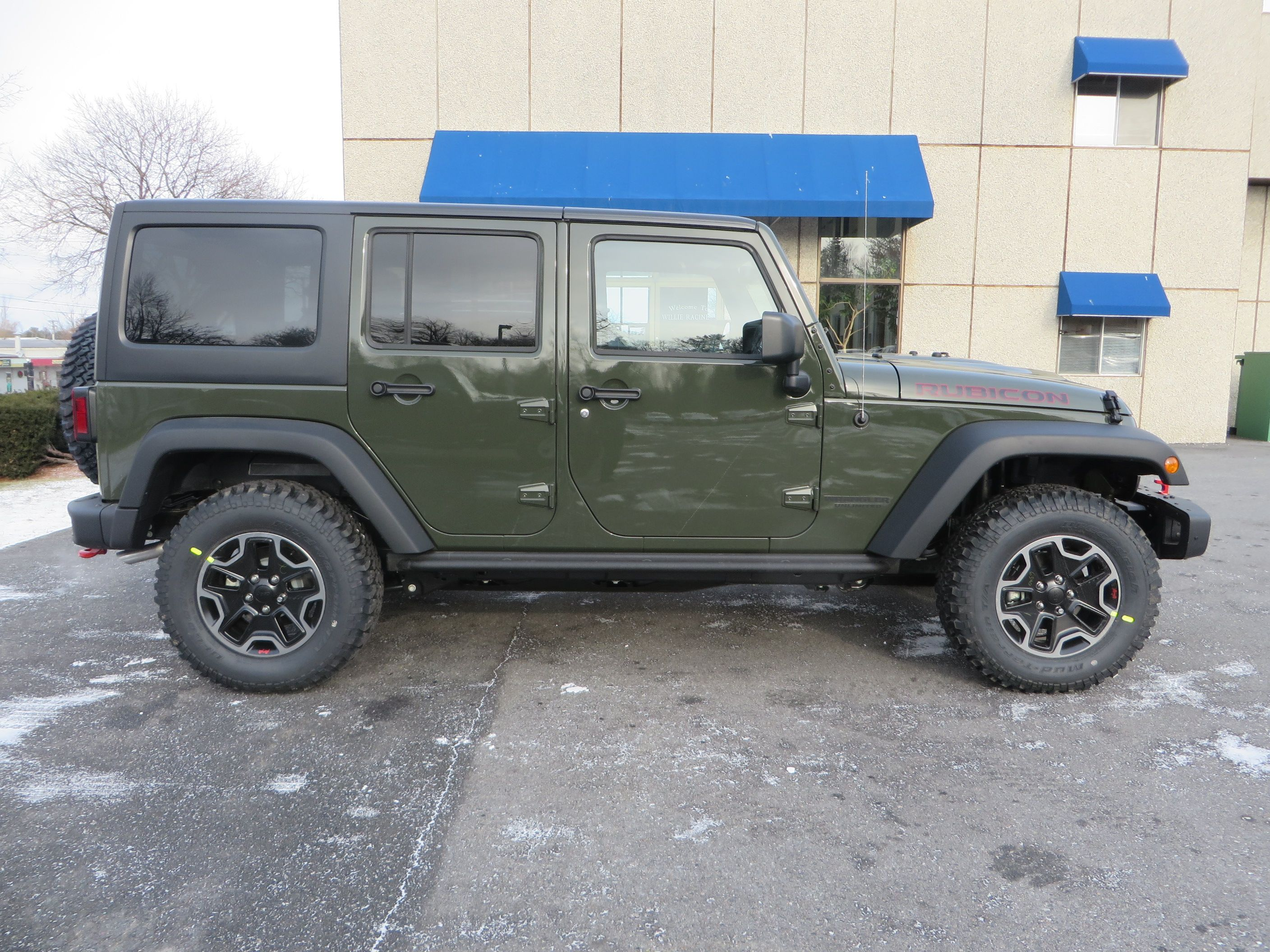 2015 Jeep Wrangler Unlimited Rubicon in Tank Green. Just