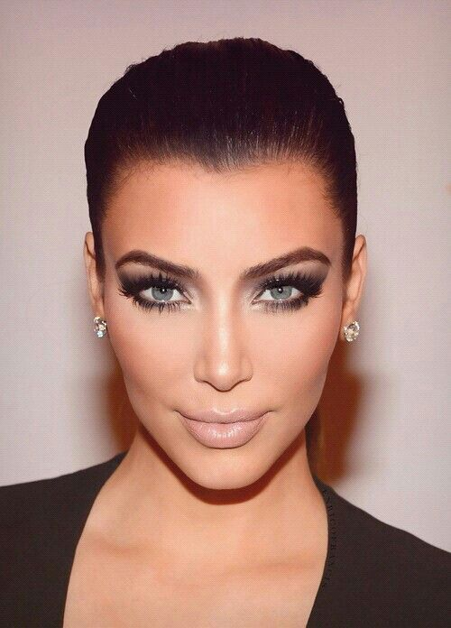 Kim Kardashian w blue contacts!  She looks COMPLETELY different.  I love her dark eyes better