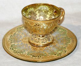 Lot: 101430: GOLD DECORATED GLASS TEA CUP & SAUCER, Lot Number: 101430, Starting Bid: $25, Auctioneer: DuMouchelles, Auction: DuMouchelles October 13, 14 & 15 Auction, Date: October 14th, 2006 CEST