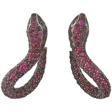 18k White Gold Ruby Emerald Snake Earrings. Approximate Current Retail In Boucheron is $80,000. DESIGNER: Boucheron MATERIAL: 18K Gold GEMSTONE: Diamond, Ruby, Emerald DIMENSIONS: The earrings measure