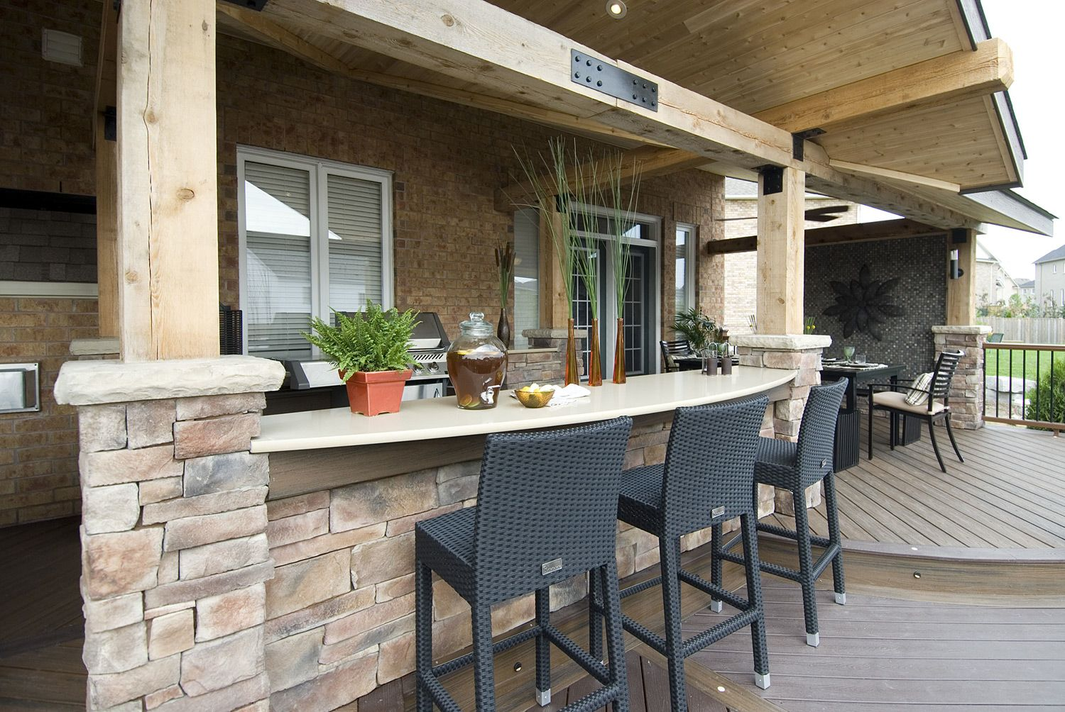 a dining bar opposite the barbeque is a perfect place for serving