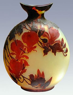 Émile Gallé                                  Large glass bottle decorated with layered red magnolias.