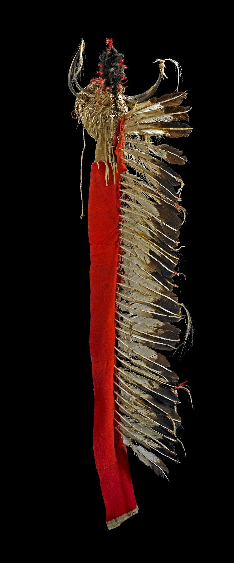 Head-dress (with fringe) made of leather, horns, cloth (serge), feathers, quills (porcupine).
