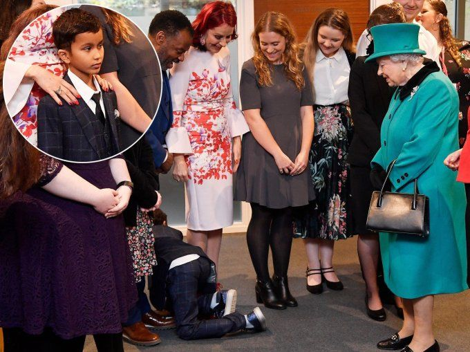 Boy so overwhelmed by Queens visit he immediately crawls out of room