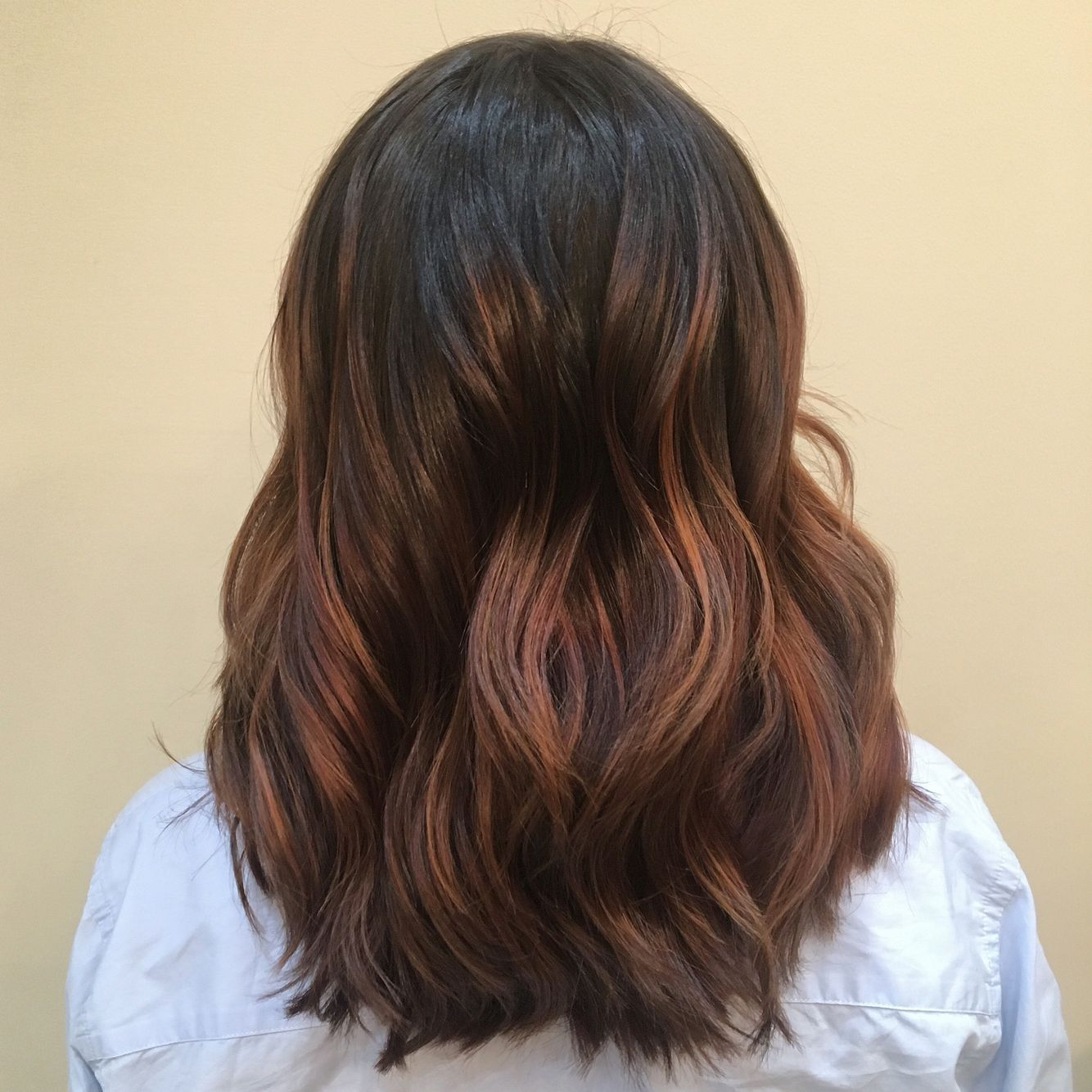 Texturized haircut choppy with balayage hair color dark roots copper