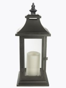 Beautiful Paradise Metal Lantern with a flameless candle inside. Would love to see this outside on a stone porch, but safe for indoors too!