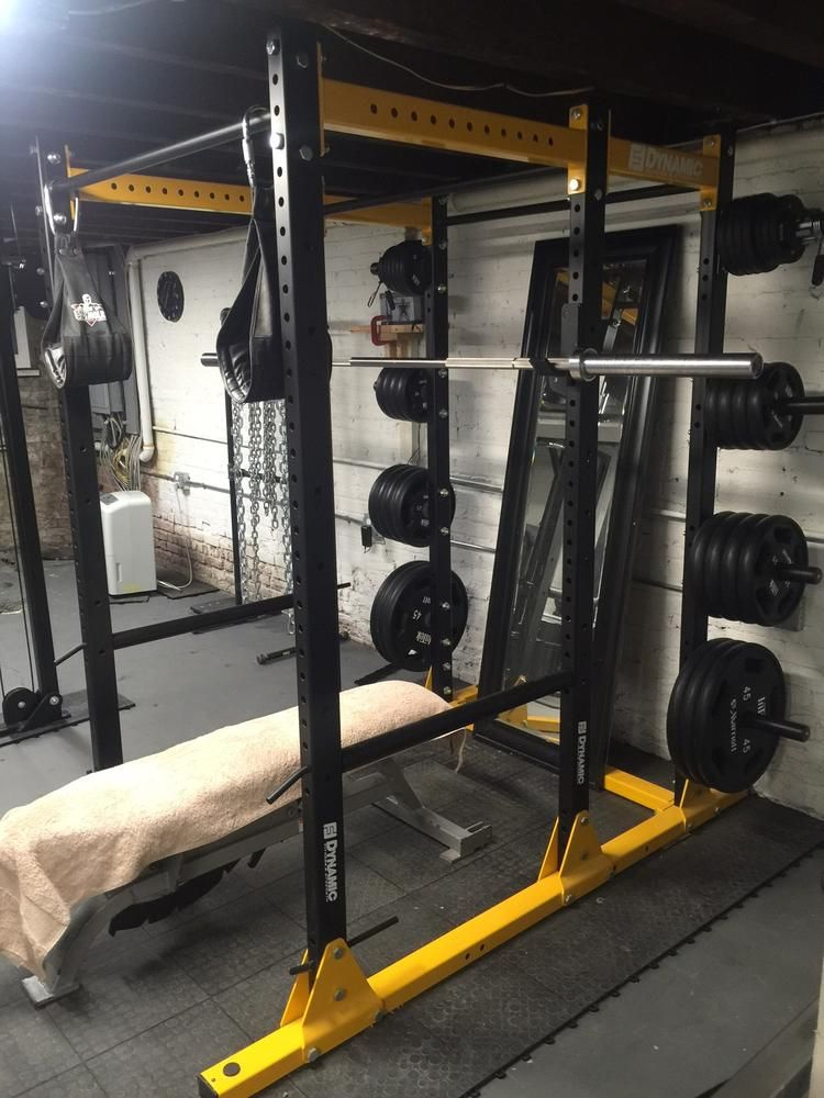 Dynamic fitness power rack in a basement home gym