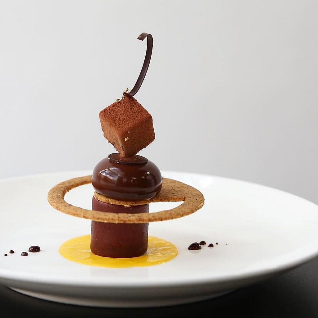 Repost Valrhonausa Valrhonac3 Celeste Plated Dessert By Pastry Chef Damiengendron From Guanaja 70 Chocolate Moelleux Mikan And Flowing Yuzu Jui Fancy Desserts Fancy Desserts Recipes Plated Desserts