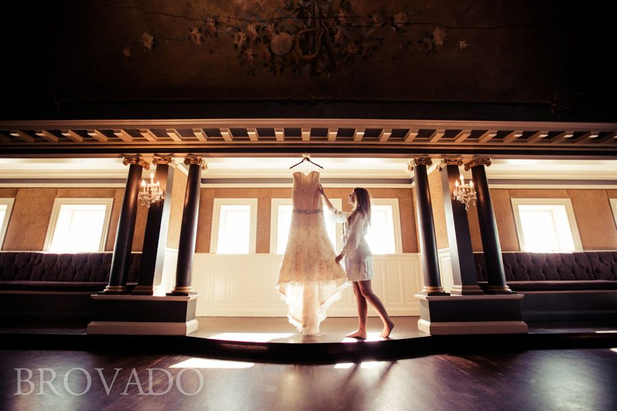 Bride looks at wedding gown | Photo by BROVADO Weddings | Semple Mansion, Minneapolis MN