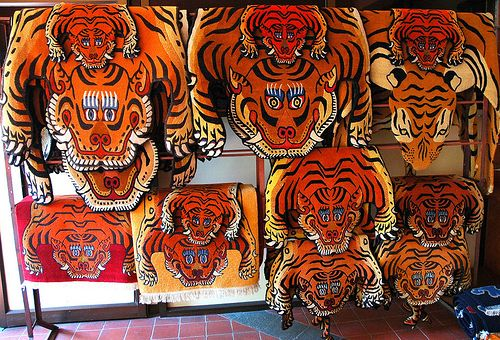 A Collection Of Tiger Rugs Tibetan