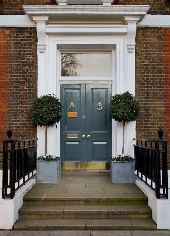 double doors with brass lion head knockers brass kick plates and potted trees. & double doors with brass lion head knockers brass kick plates and ...