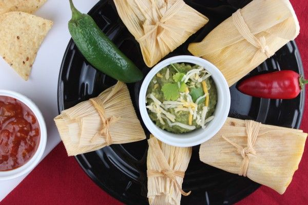 These homemade tamales are filled with a sweet corn masa mixture and shredded chicken for a deliciously authentic and gluten free Mexican dinner recipe.