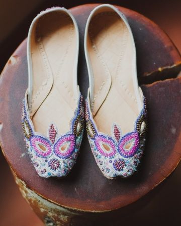 3043189fb01a This bride wore hand-beaded Indian wedding slippers to add a pop of color  to her dress