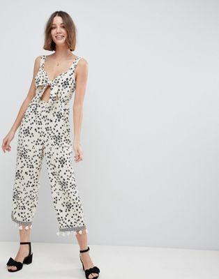 40af110c12 ASOS DESIGN floral jumpsuit with cut out and tie detail ...