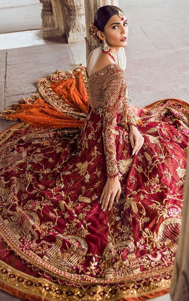 e8bb5cafdd Deep red bridal gown with worked bodice and fully embellished sleeves. Gold  mesh handwork on shirt bodice. Floral patterned embroidery of tilla, ...