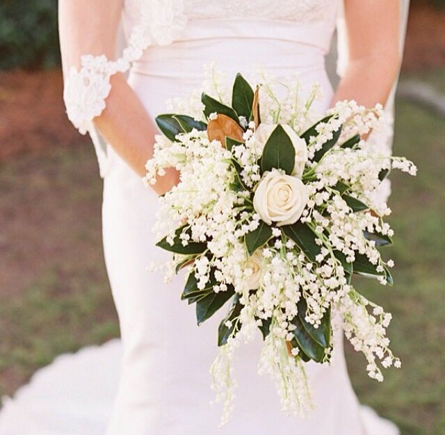 White Roses Baby S Breath And Magnolia Leaves Magnolia Wedding