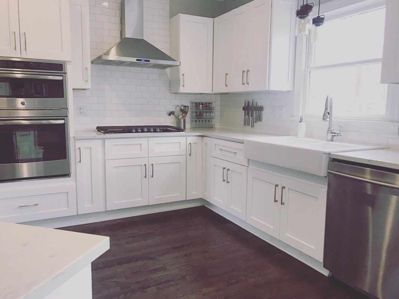 All white kitchen with ebony jacobean hardwood floors | white shaker ...
