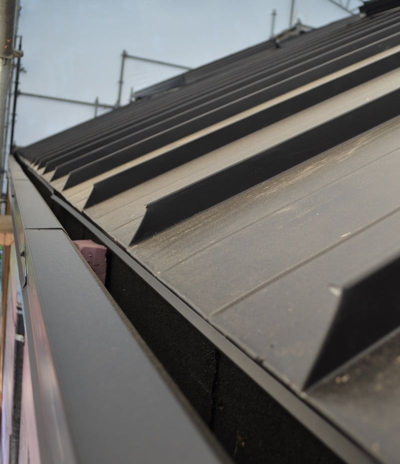 Metal Standing Seam Roof Detail At Concealed Gutter In