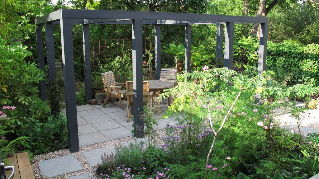 Mature garden with pergola hege in france courtyard garden