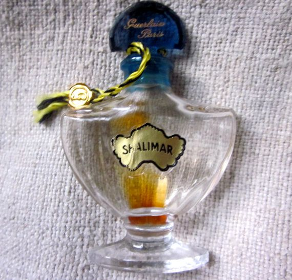 Vintage 1960's Shalimar Bottle with Charm by angelinabella on Etsy