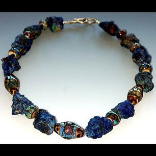 Lampworked glass beads and rough lapis.