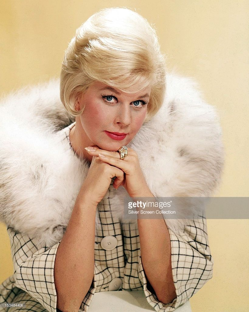 American actress Doris Day in a fur-trimmed coat, circa 1963. #hollywoodlegends