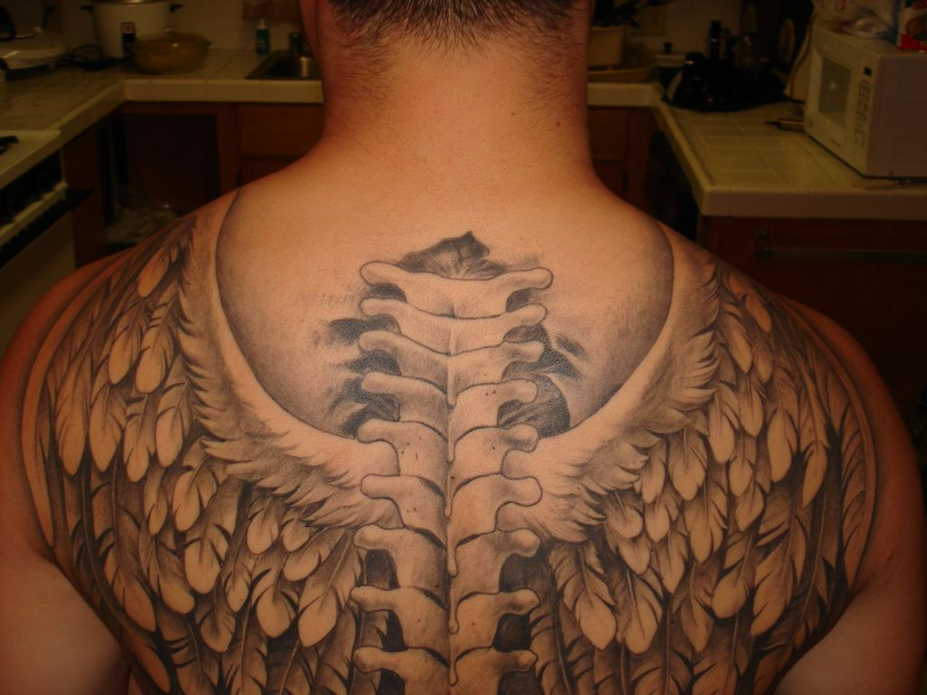 Guy Tattoo Designs: Angel Wing Tattoos For Men