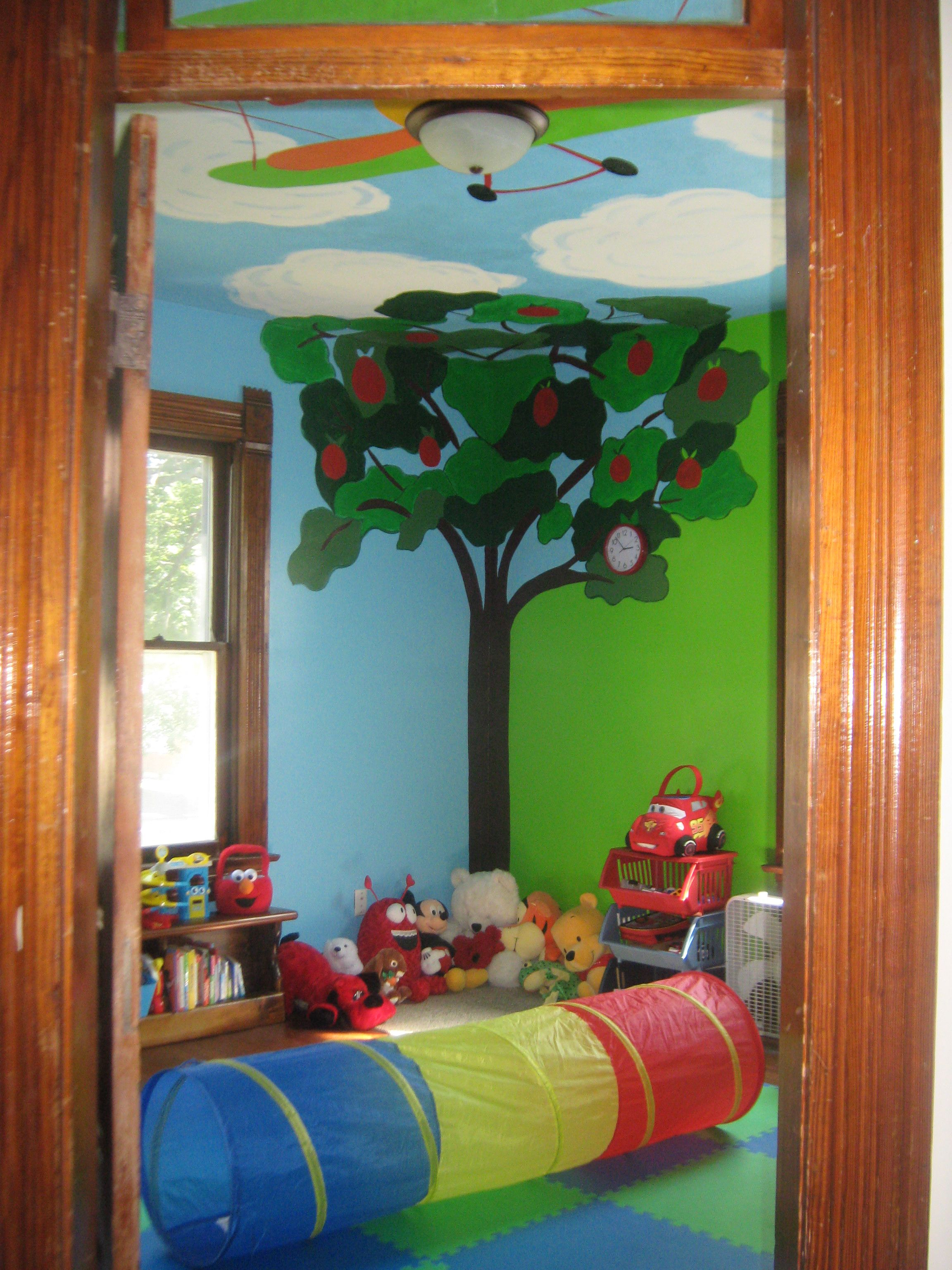 View of playroom's quiet area and play mat.