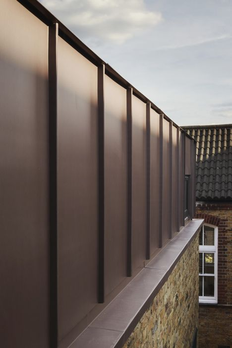 Zinc cladding at classroom extension by studio webb for Architecture zinc