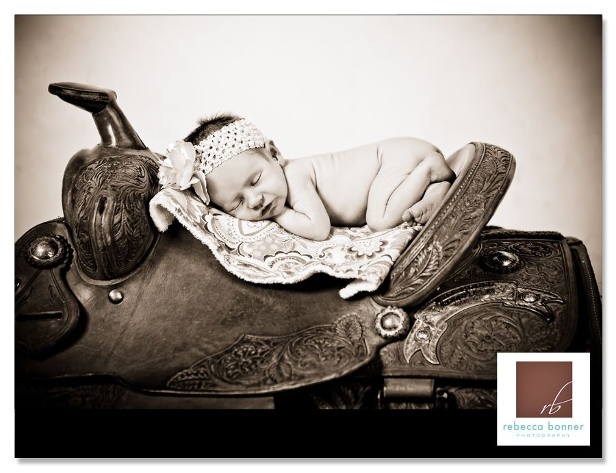 Newborn baby on a saddle