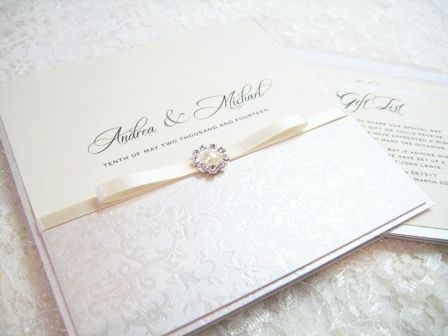 Simple traditional ivory wedding invitations with ivory ribbons and pearls
